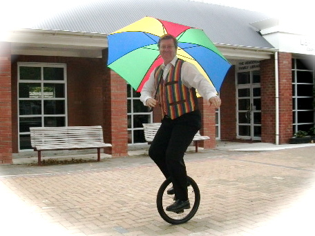 Shad Rutherford in a suit on a unicycle?